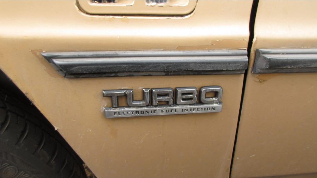27 - 1985 Dodge 600 convertible in Arizona wrecking yard - photo by Murilee Martin