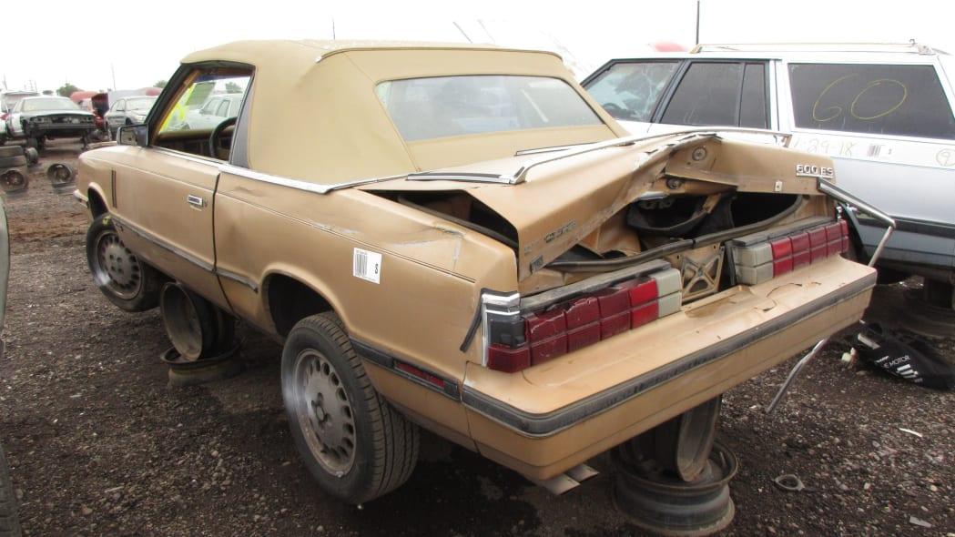 37 - 1985 Dodge 600 convertible in Arizona wrecking yard - photo by Murilee Martin