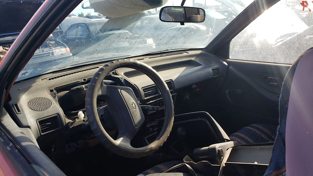 24 - 1990 Daihatsu Charade in Colorado junkyard - Photo by Murilee Martin