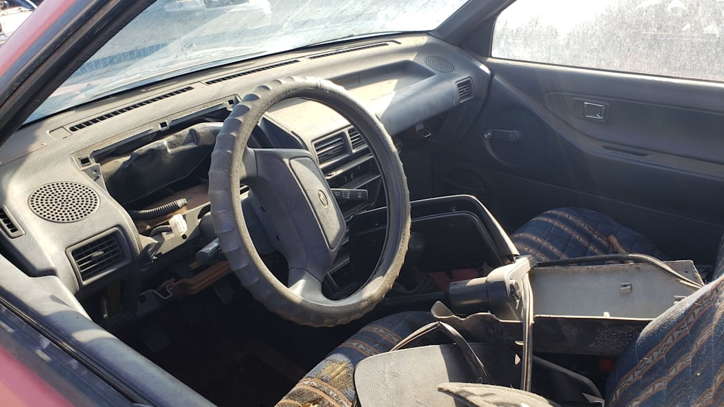 25 - 1990 Daihatsu Charade in Colorado junkyard - Photo by Murilee Martin