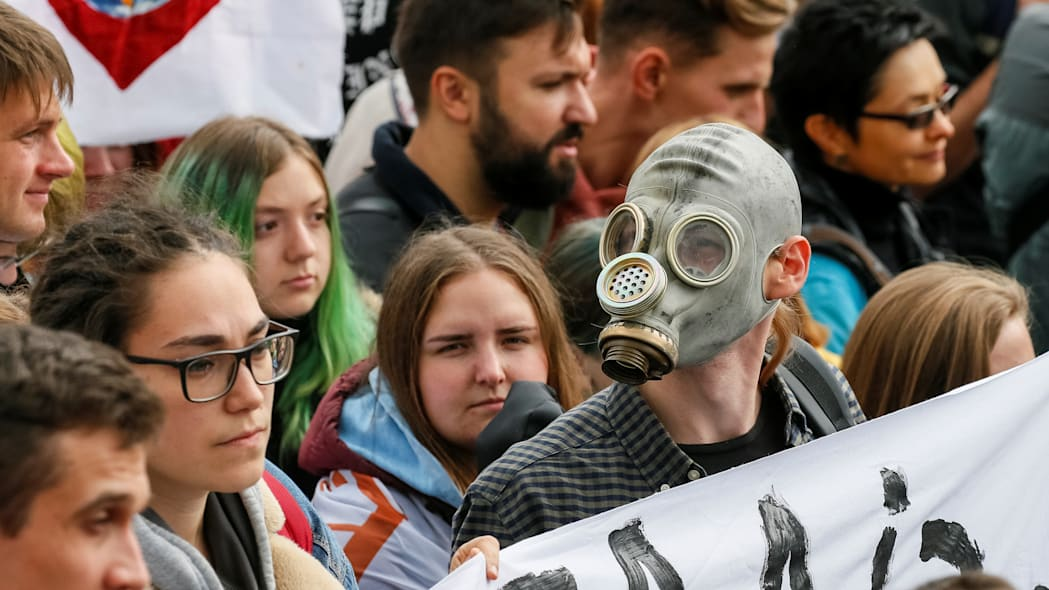 Ukrainian activists take part in a rally demanding actions on climate change in Kiev