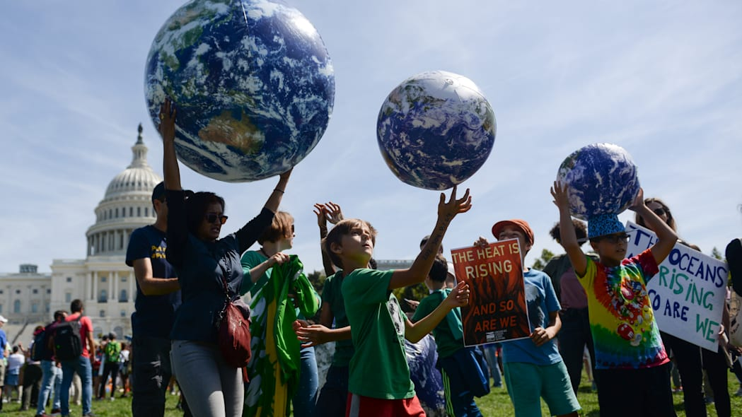 Young protesters participate in a rally near the U.S. Capitol as part of the D.C. Climate Strike March to demand action on climate change in Washington