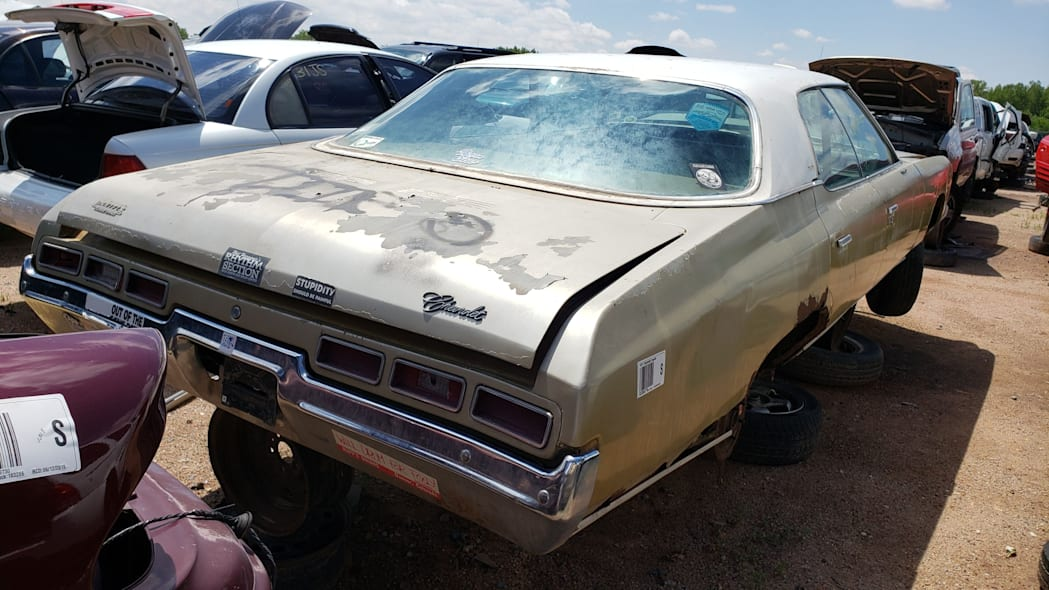 57 - 1971 Chevrolet Impala in Colorado wrecking yard - photo by Murilee Martin