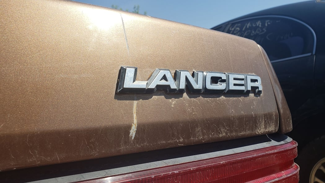 06 - 1986 Dodge Lancer in Colorado wrecking yard - photo by Murilee Martin