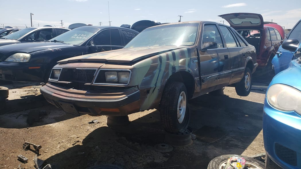 42 - 1986 Dodge Lancer in Colorado wrecking yard - photo by Murilee Martin