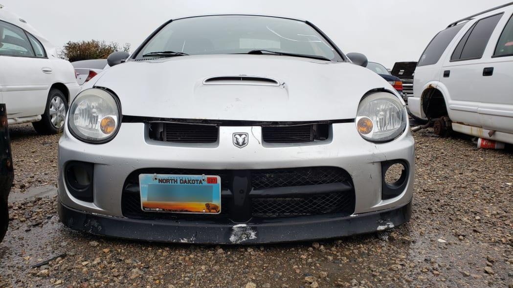 19 - 2005 Dodge Neon in North Dakota wrecking yard - photograph by Murilee Martin