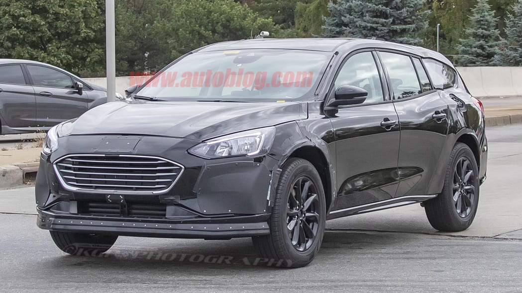 Ford Fusion-size crossover spied with lifted wagon looks