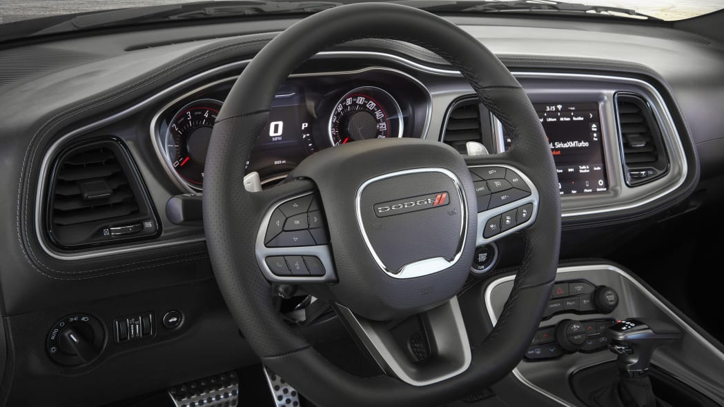 New flat-bottom leather steering wheel included with Widebody pa
