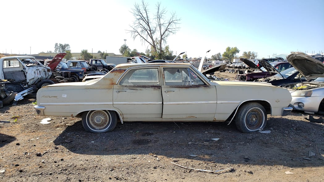 57 - 1965 Chevrolet Malibu in Colorado junkyard - photo by Murilee Martin