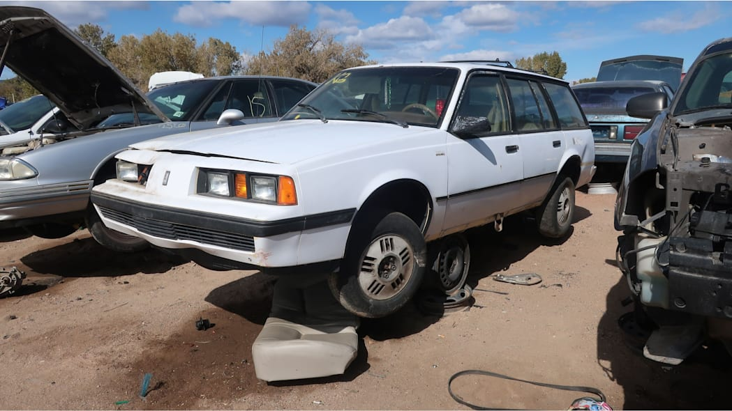 00 - 1987 Oldsmobile Firenza wagon in Colorado junkyard - photo by Murilee Martin