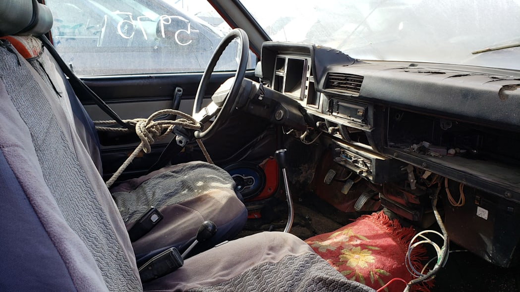 53 - 1980 Datsun 4x4 Pickup in California junkyard - photo by Murilee Martin