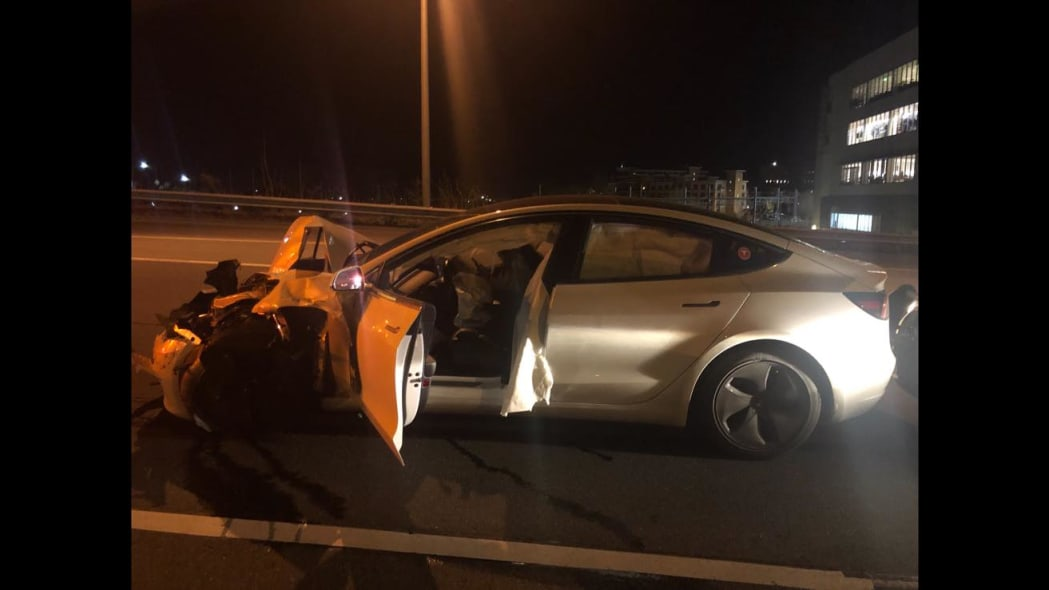 Tesla Model 3 on Autopilot slams into two parked cars, one a police cruiser