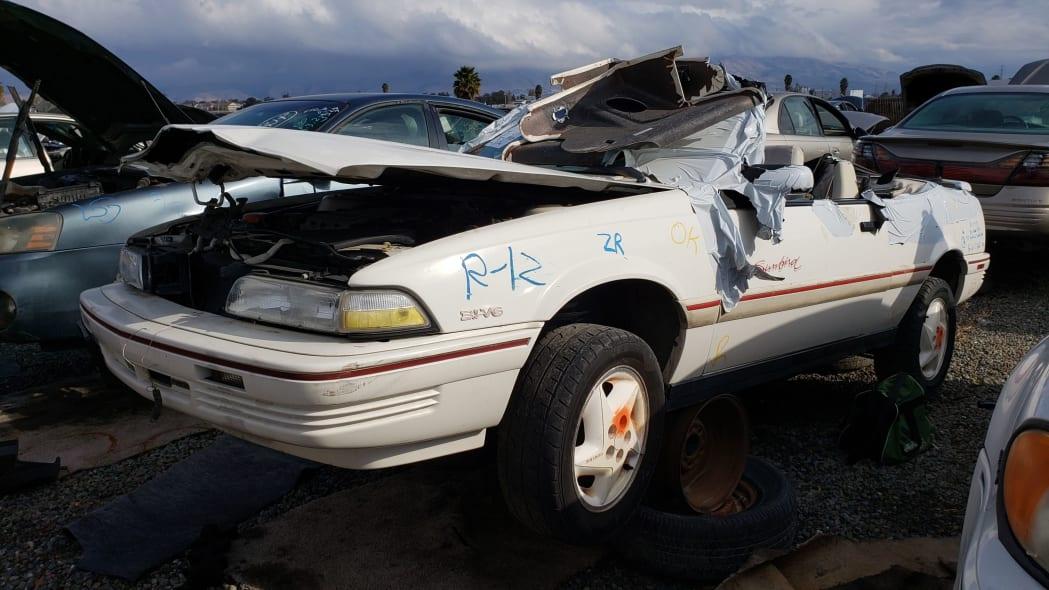 00 - 1992 Pontiac Sunbird convertible in California junkyard - photo by Murilee Martin
