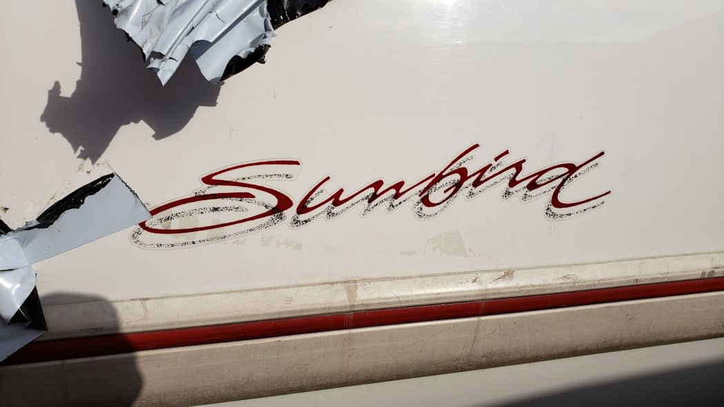 02 - 1992 Pontiac Sunbird convertible in California junkyard - photo by Murilee Martin