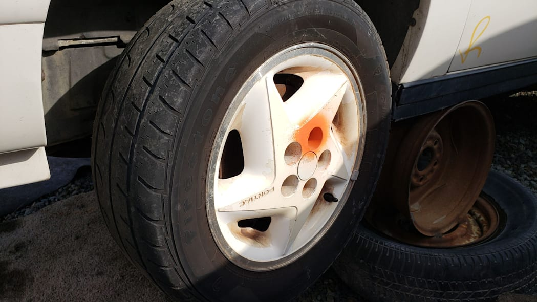 11 - 1992 Pontiac Sunbird convertible in California junkyard - photo by Murilee Martin