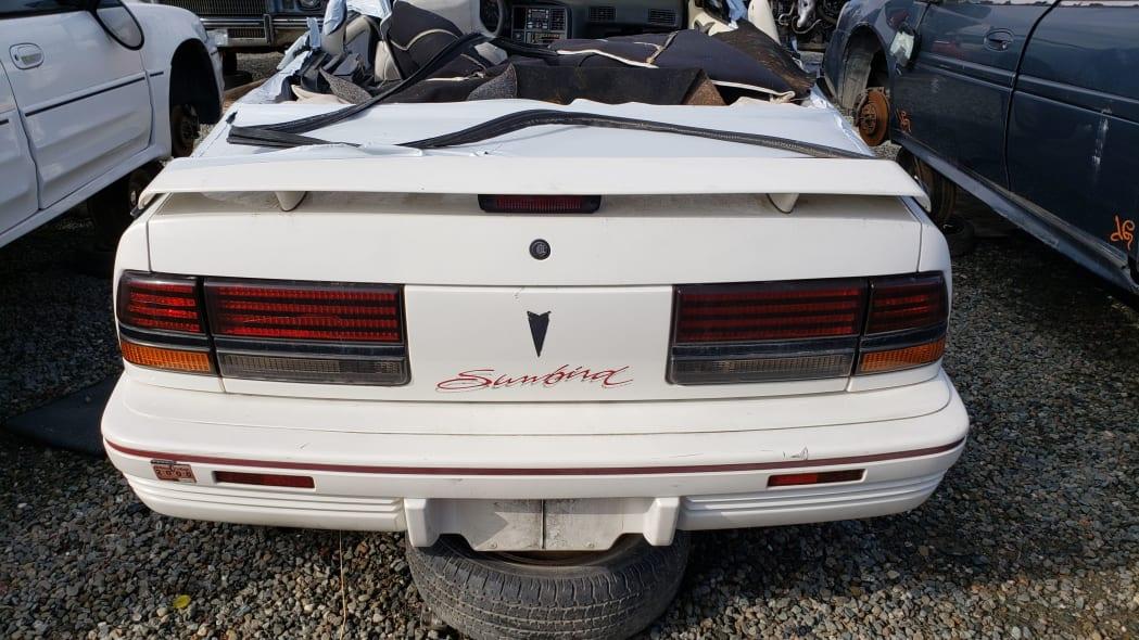 23 - 1992 Pontiac Sunbird convertible in California junkyard - photo by Murilee Martin
