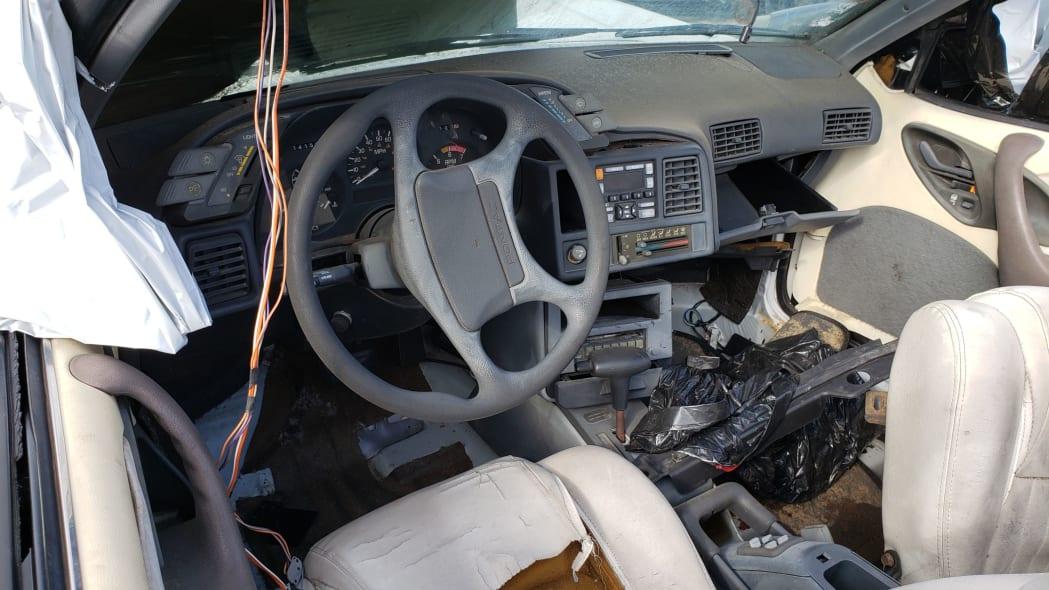 27 - 1992 Pontiac Sunbird convertible in California junkyard - photo by Murilee Martin