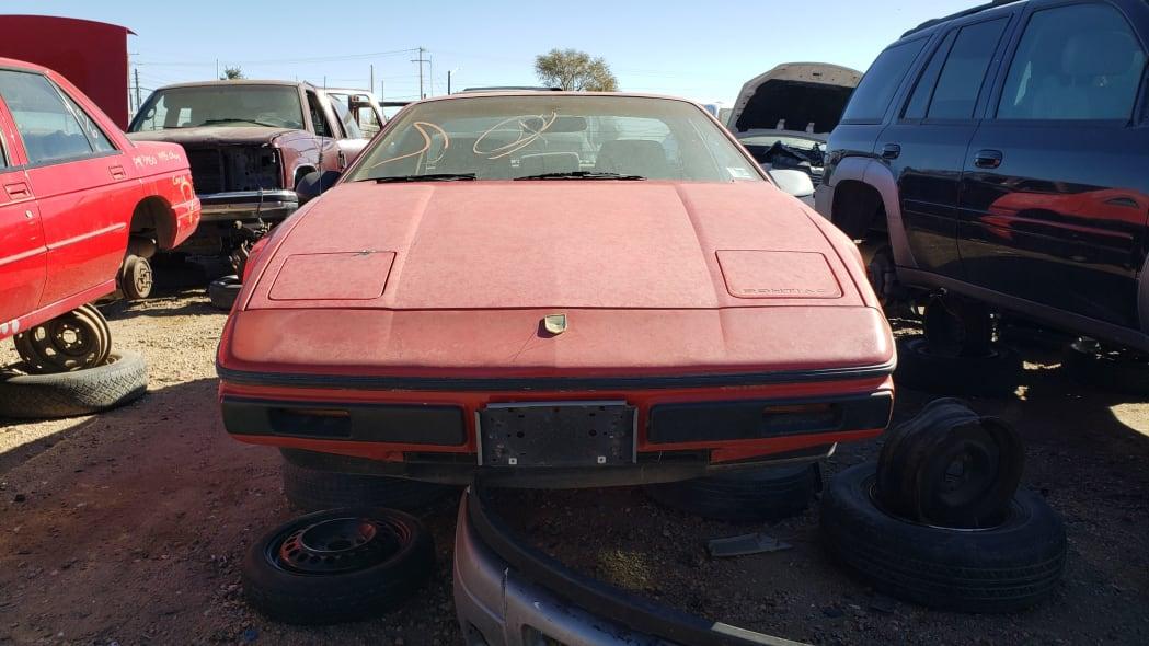23 - 1984 Pontiac Fiero in Colorado junkyard - photo by Murilee Martin