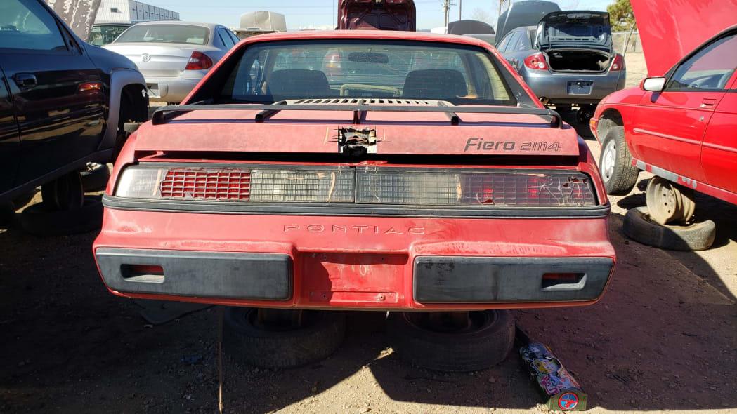 31 - 1984 Pontiac Fiero in Colorado junkyard - photo by Murilee Martin
