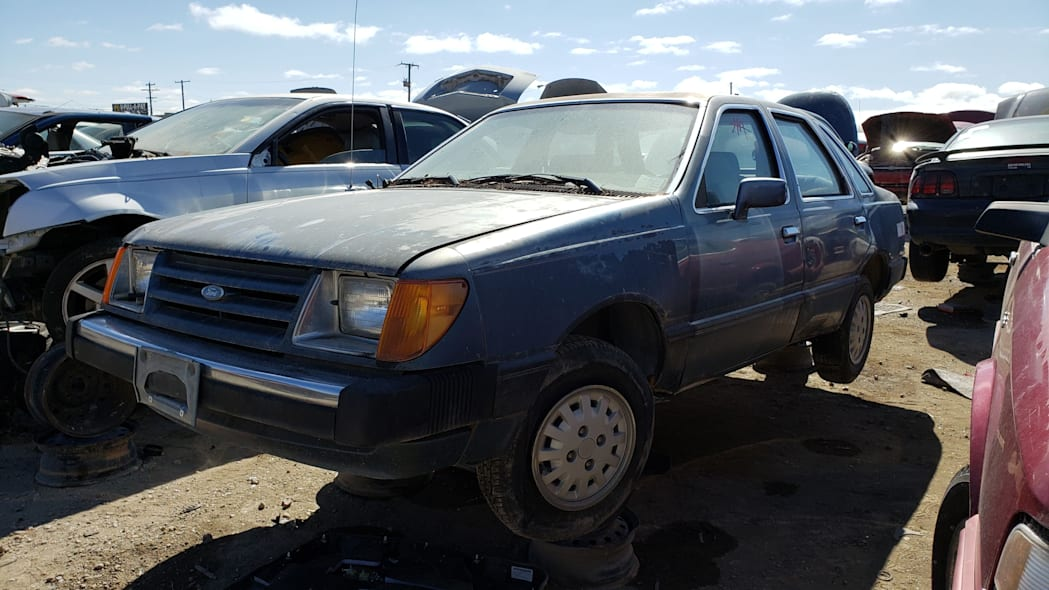 17 - 1985 Ford Tempo in Colorado junkyard - photo by Murilee Martin
