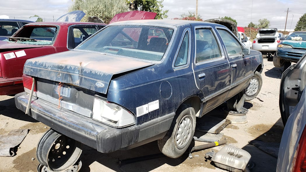 22 - 1985 Ford Tempo in Colorado junkyard - photo by Murilee Martin