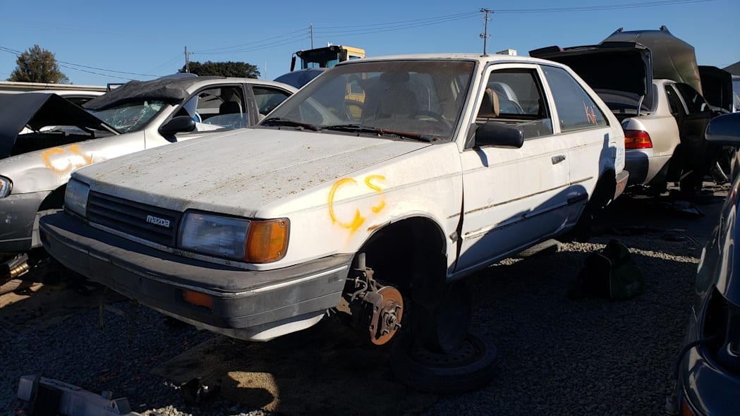 29 - 1986 Mazda 323 in California junkyard - photo by Murilee Martin