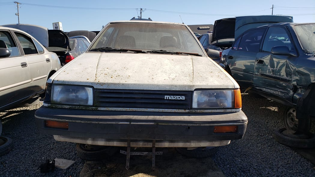 31 - 1986 Mazda 323 in California junkyard - photo by Murilee Martin