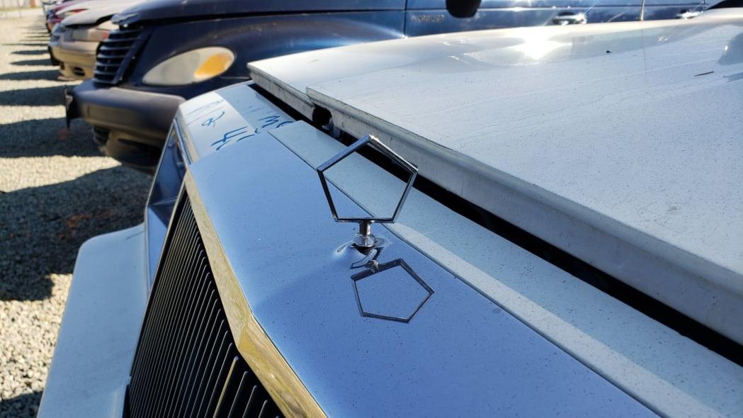 17 - 1982 Chrysler LeBaron convertible in California junkyard - photo by Murilee Martin