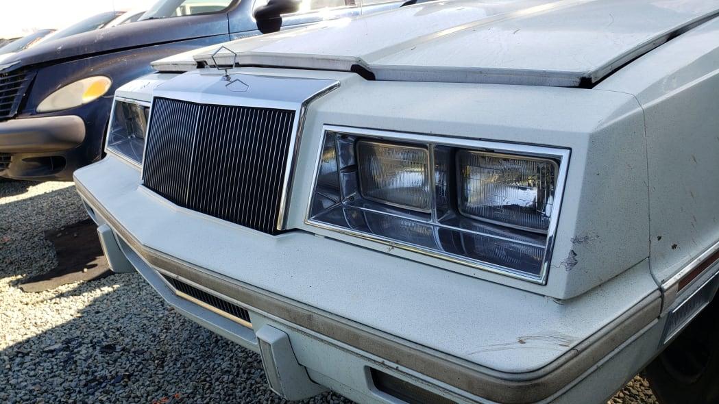 18 - 1982 Chrysler LeBaron convertible in California junkyard - photo by Murilee Martin