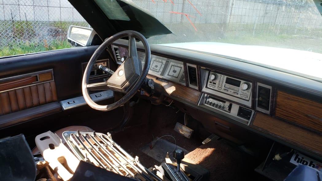 37 - 1982 Chrysler LeBaron convertible in California junkyard - photo by Murilee Martin