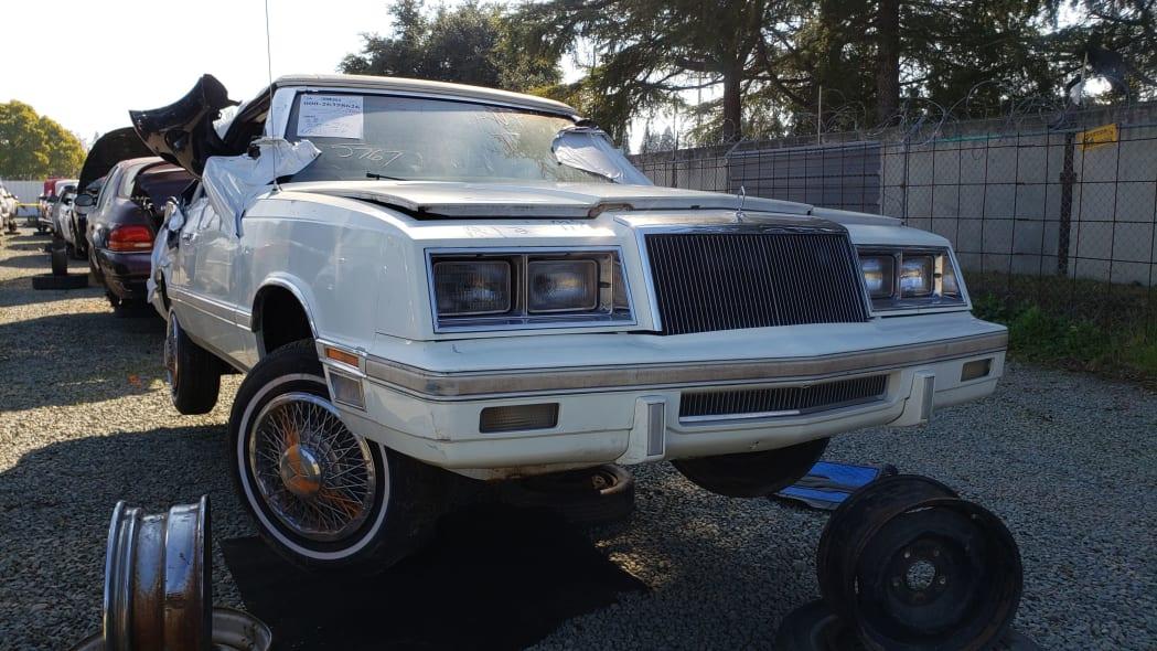 39 - 1982 Chrysler LeBaron convertible in California junkyard - photo by Murilee Martin