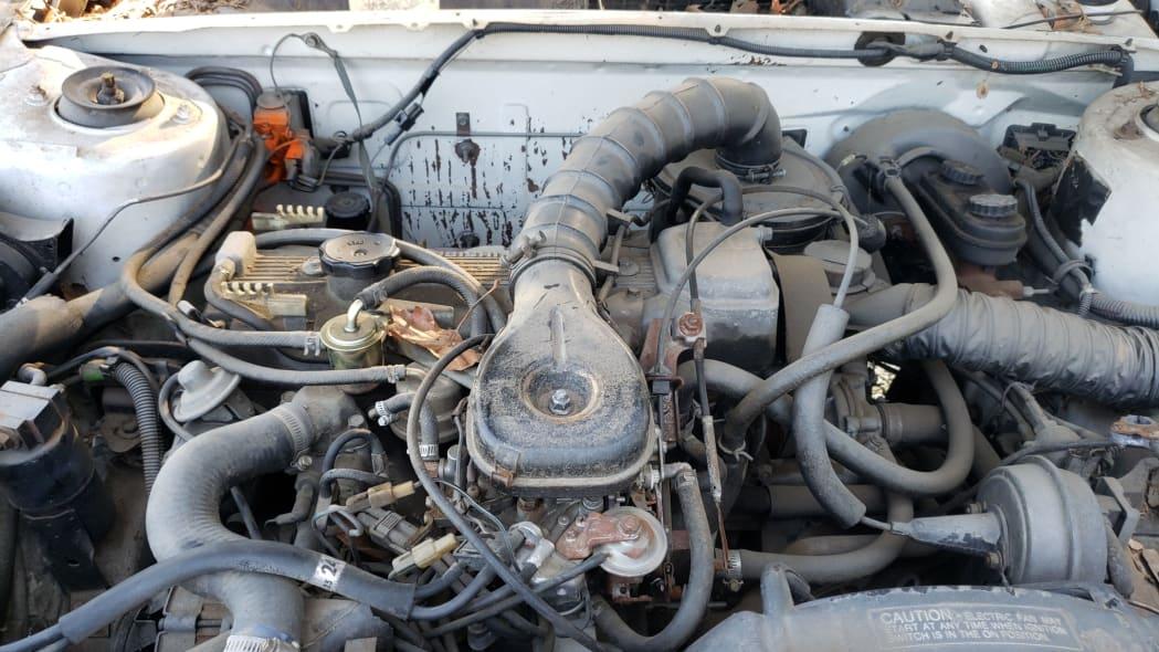 45 - 1982 Chrysler LeBaron convertible in California junkyard - photo by Murilee Martin