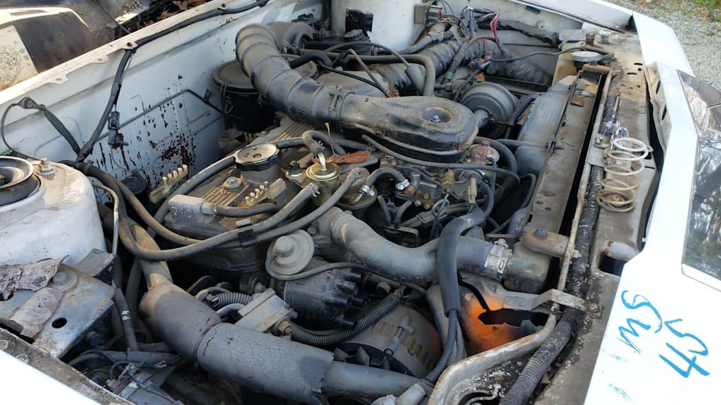 54 - 1982 Chrysler LeBaron convertible in California junkyard - photo by Murilee Martin