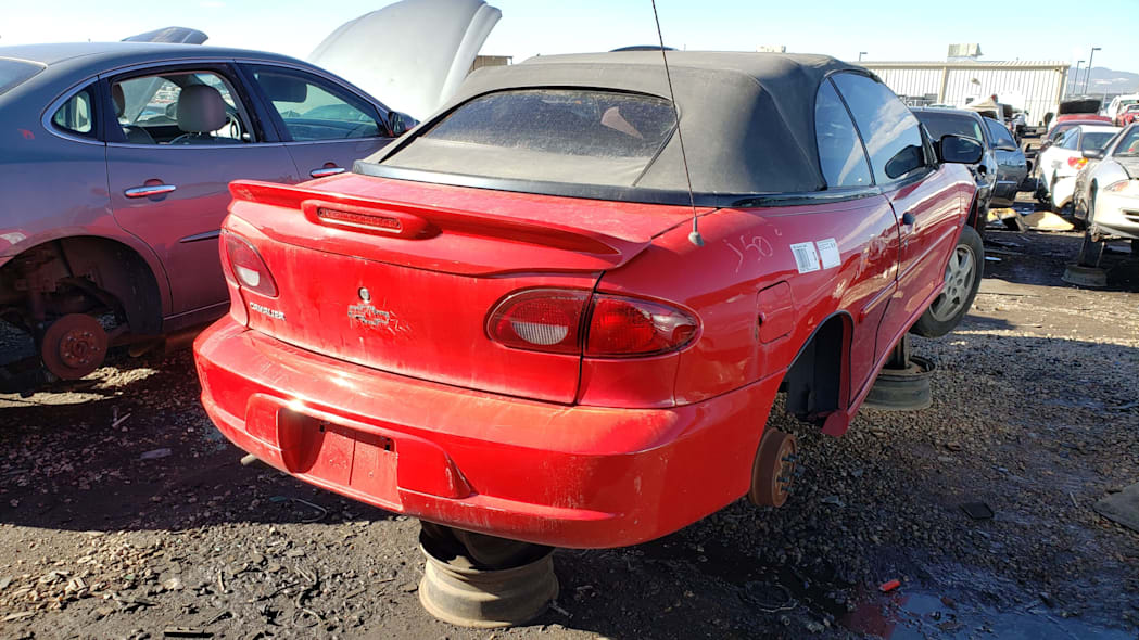 40 - 2000 Chevrolet Cavalier Z24 convertible in Colorado junkyard - photo by Murilee Martin