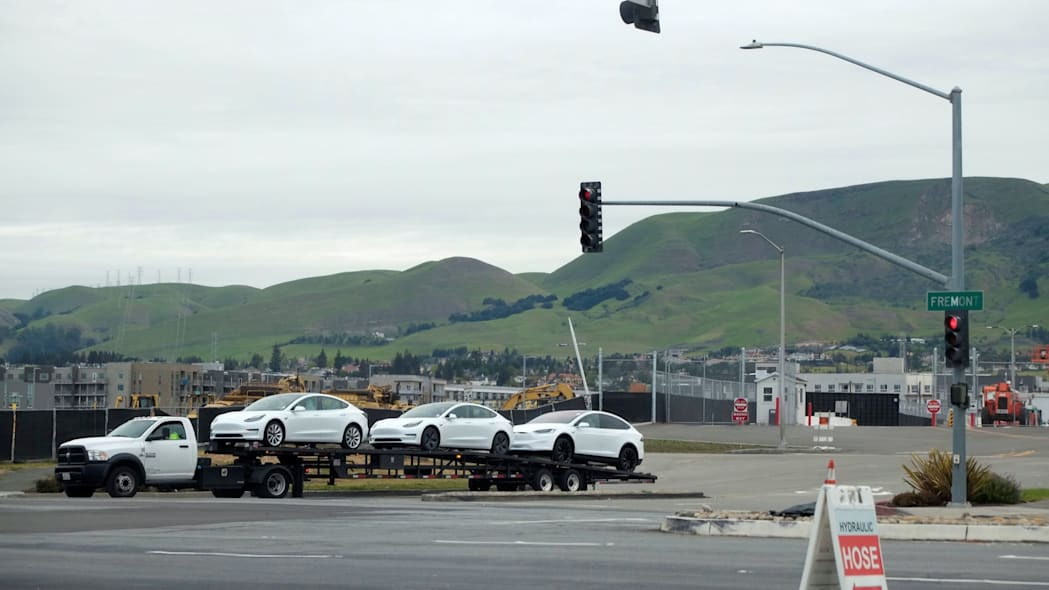 Vehicles on a trailer bed are seen leaving a Tesla Inc's U.S. vehicle factory in Fremont, California