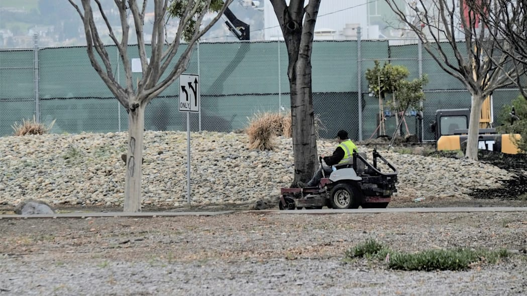 A landscaping contractor finishes work at Tesla Inc's Fremont, California factory