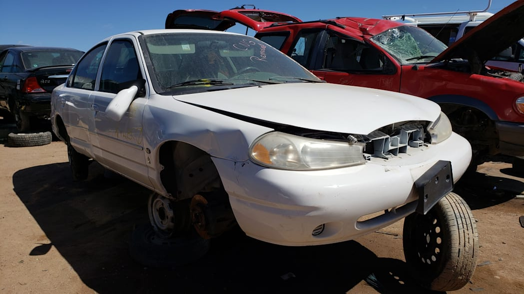 30 -1999 Ford Contour CNG in Colorado Junkyard - photo by Murilee Martin