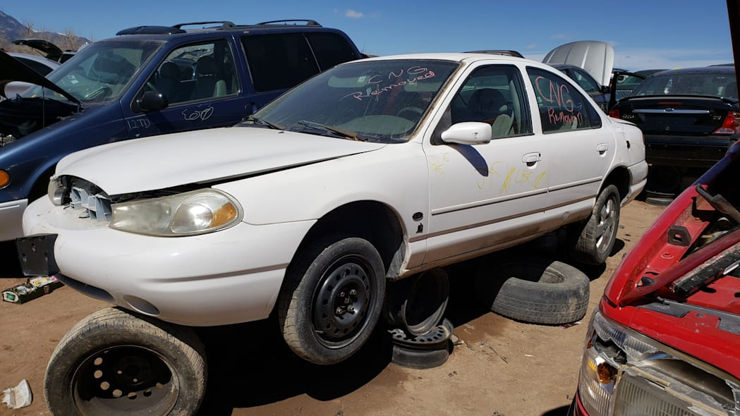 33 -1999 Ford Contour CNG in Colorado Junkyard - photo by Murilee Martin