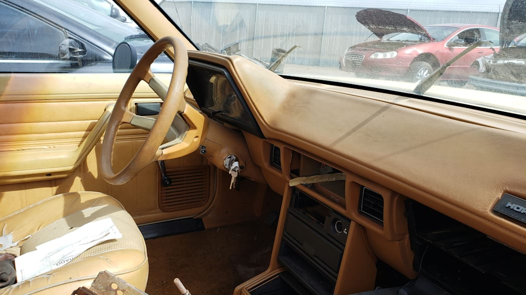 28 - 1985 Plymouth Horizon in Colorado Junkyard - photo by Murilee Martin