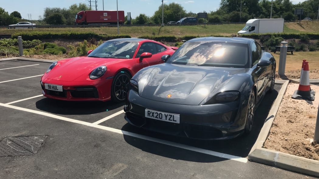 2020 Porsche Taycan Turbo and 911 Turbo front