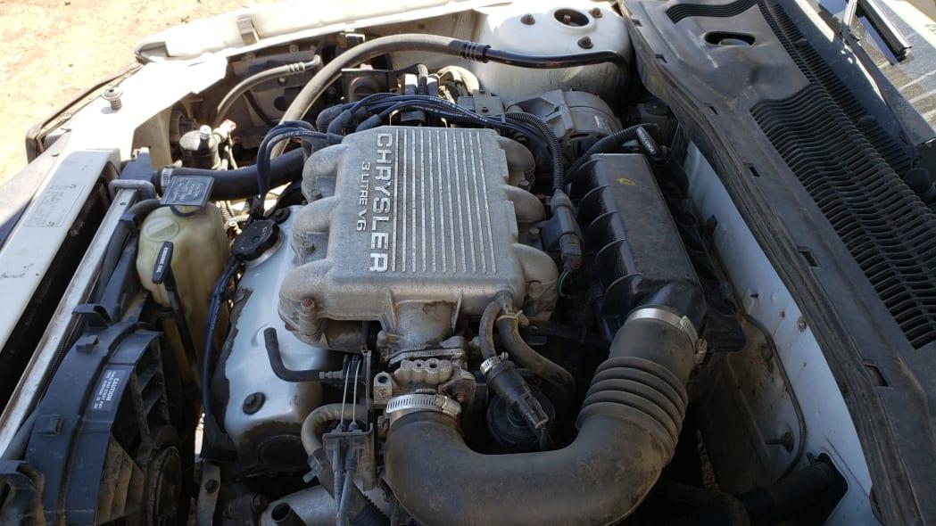 18 - 1994 Dodge Spirit in Colorado Junkyard - photo by Murilee Martin