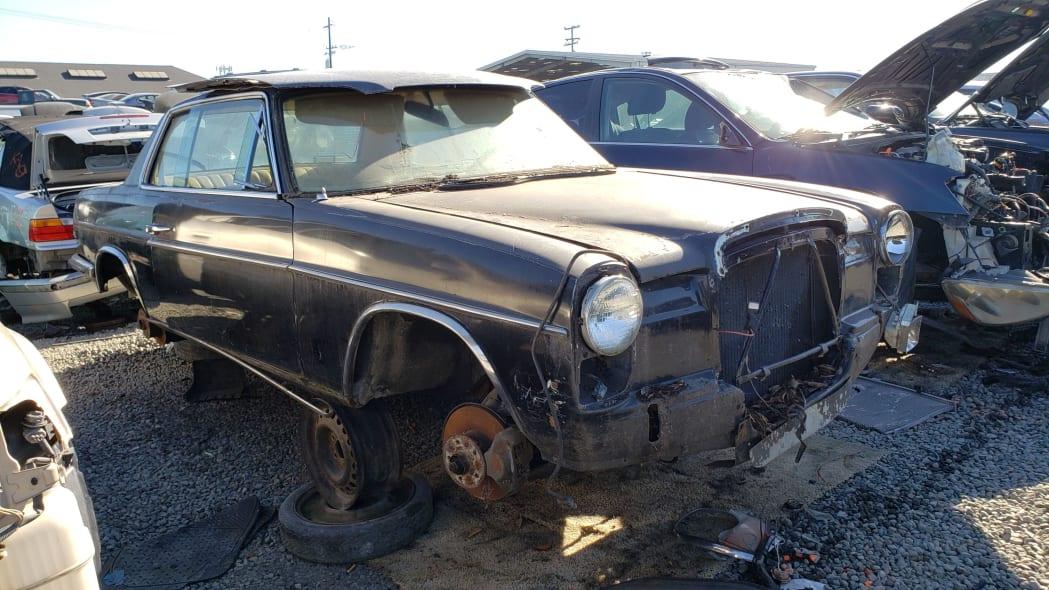 99 - 1973 Mercedes-Benz W114 in California junkyard - photo by Murilee Martin
