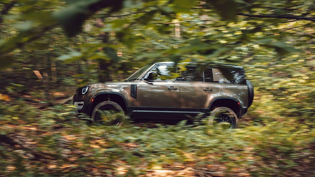 2020 Land Rover Defender brown action profile off road