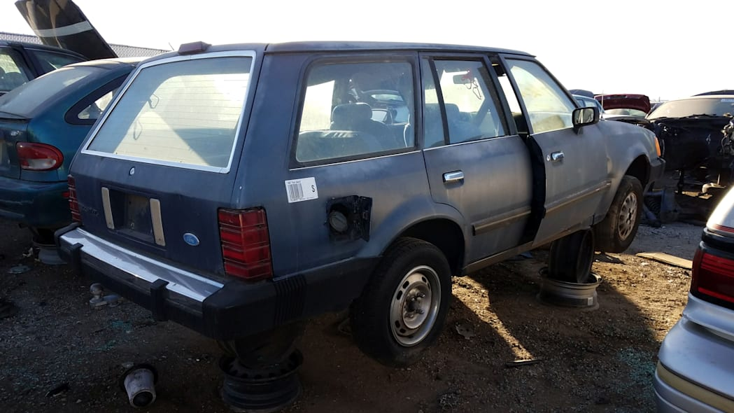 99 - 1987 Ford Escort station wagon in Colorado junkyard - photo by Murilee Martin