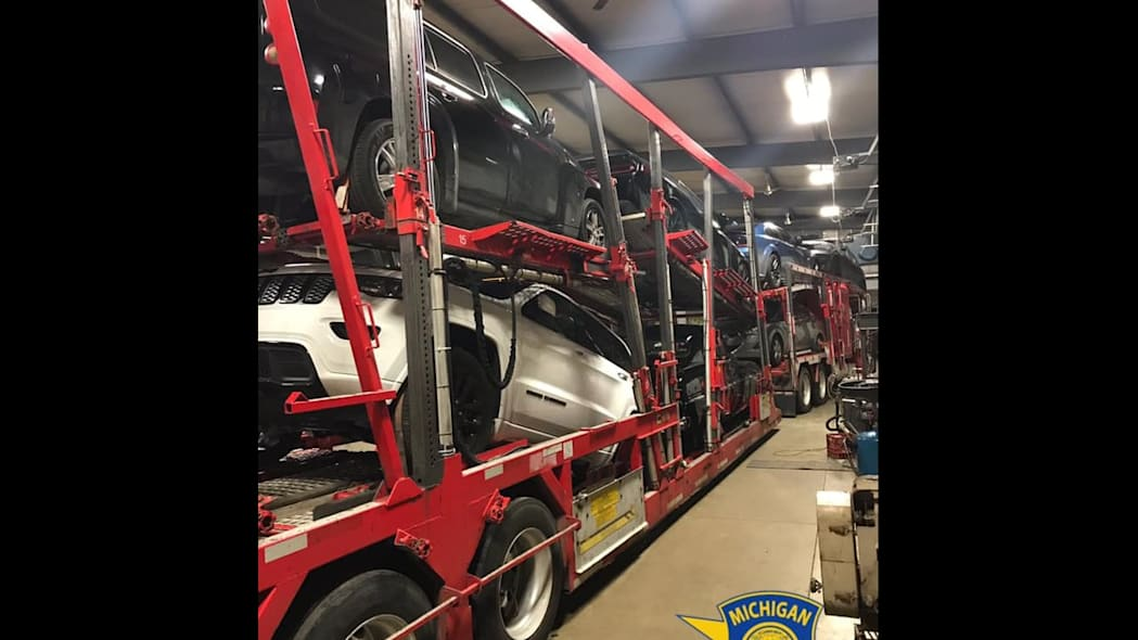 Truck loaded with stolen cars