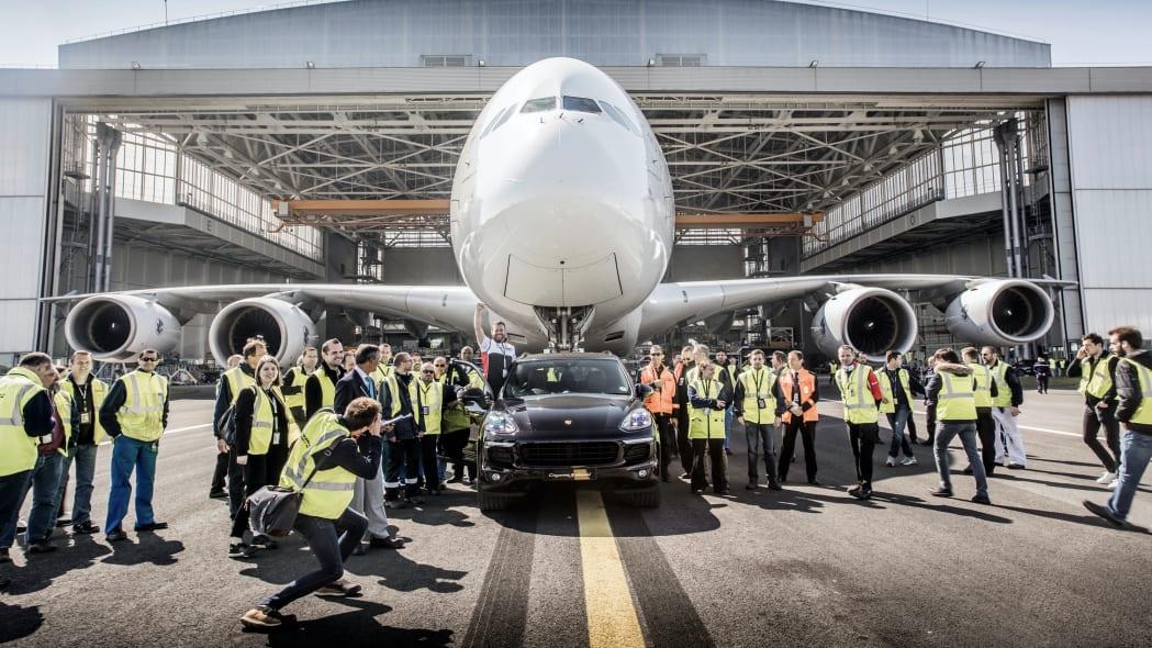 Porsche Cayenne S Diesel towing a plane