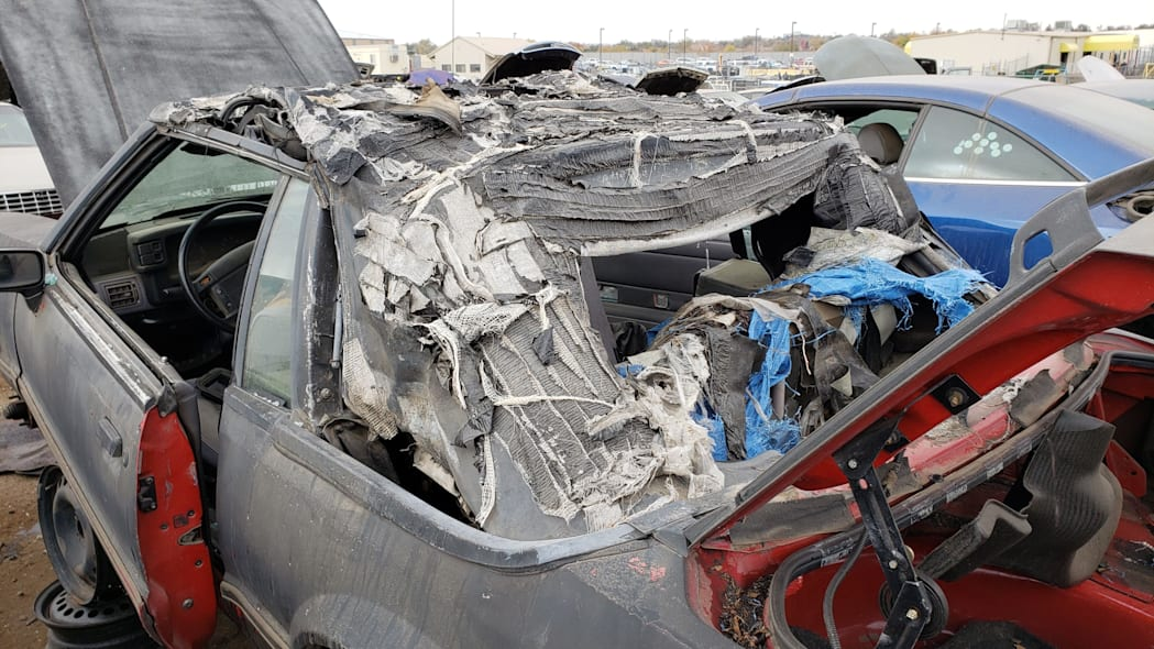 03 - 1993 Ford Mustang Convertible in Denver junkyard - photo by Murilee Martin