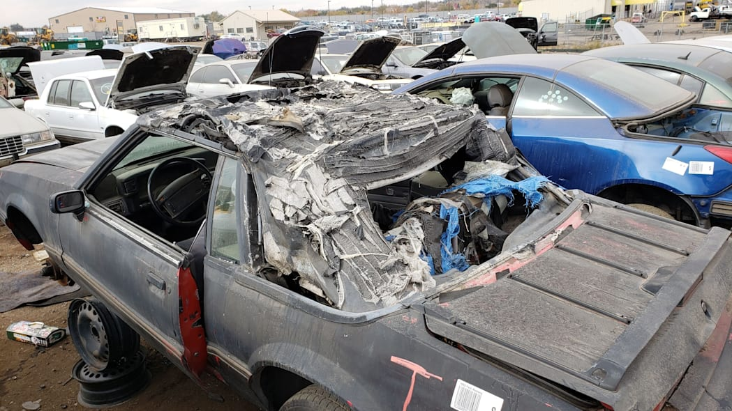 36 - 1993 Ford Mustang Convertible in Denver junkyard - photo by Murilee Martin