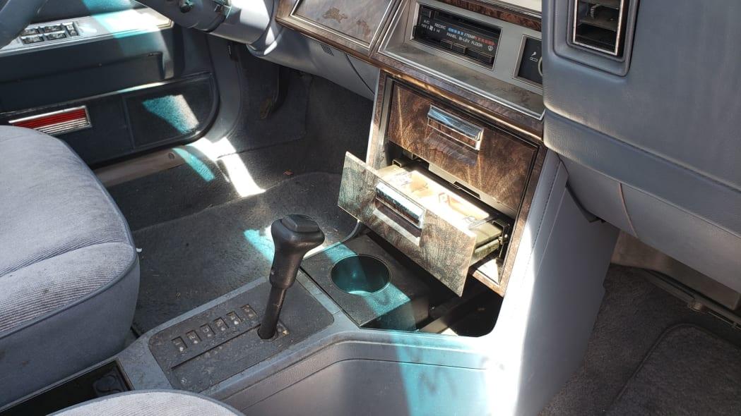 24 - 1988 Chrysler LeBaron in Colorado junkyard - photo by Murilee Martin
