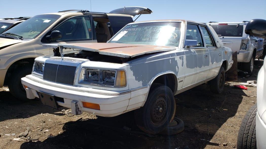 34 - 1988 Chrysler LeBaron in Colorado junkyard - photo by Murilee Martin